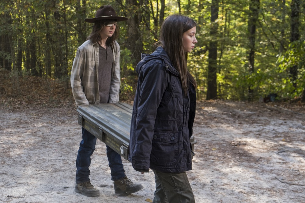 Chandler Riggs as Carl Grimes, Katelyn Nacon as Enid - The Walking Dead _ Season 7, Episode 15 - Photo Credit: Gene Page/AMC